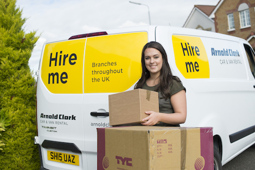 girl in front of van with a box